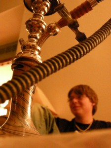 Close up of hookah with young male in background